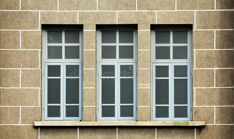 Antique grey wood window. Construction and exterior decoration background concept royalty free stock image