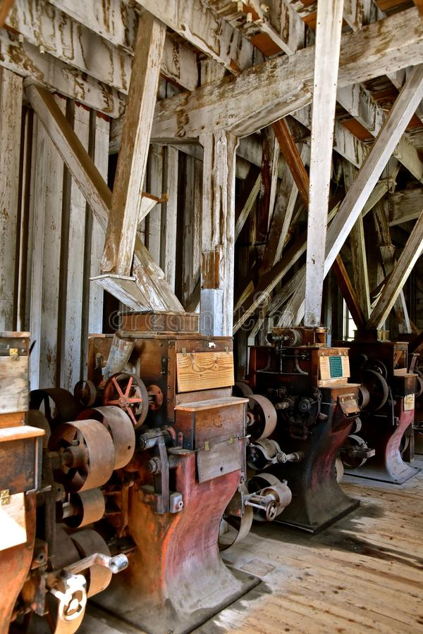 Antique grist mill equipment stock photography