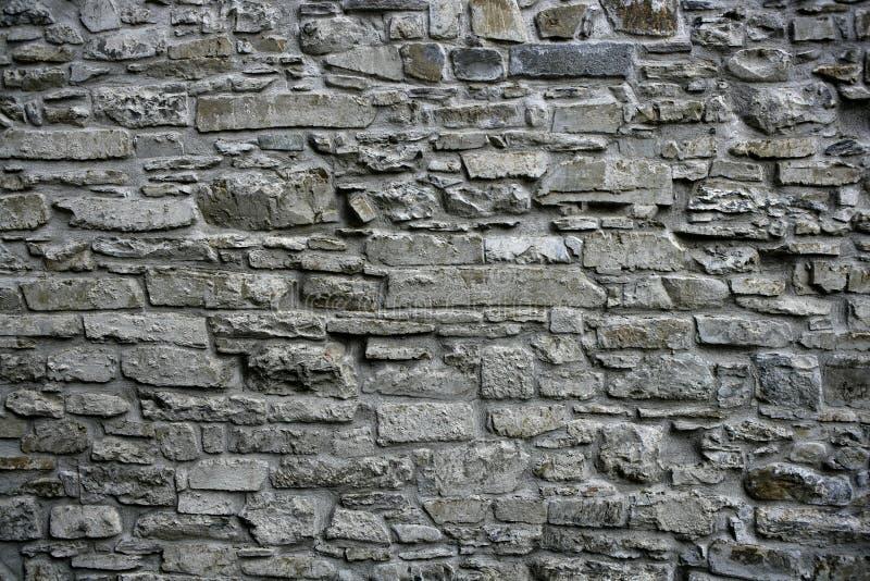 Antique grunge old gray stone wall masonry stock photos