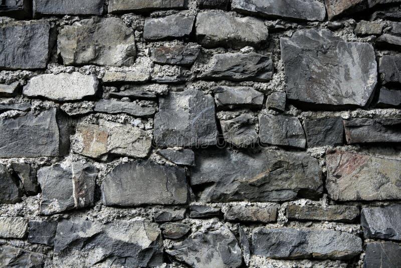 Antique grunge old gray stone wall masonry royalty free stock photography