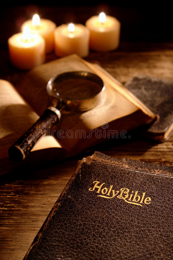 Antique Holy Bible Christian Religious Book Study. Antique Holy Bible sacred Christian religious book and rare old prayer books with vintage magnifier for stock images