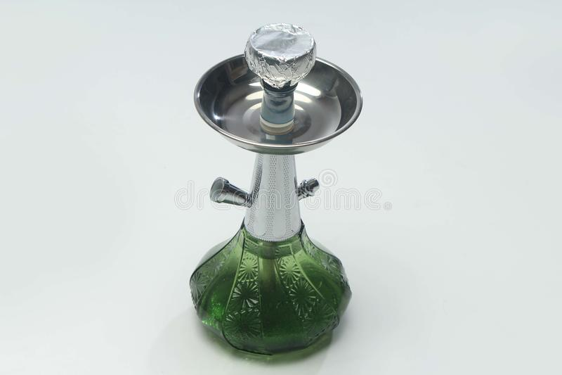 Antique hookah. Antique green transparent hookah. isolated on white background stock images