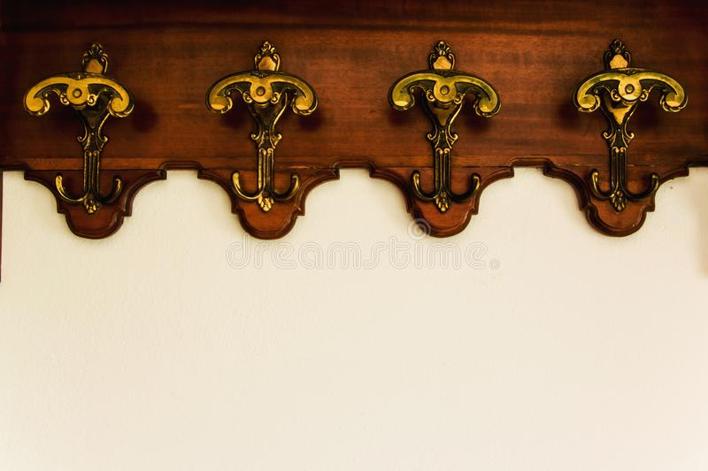 Antique hooks on the white wall. Space for text royalty free stock photos