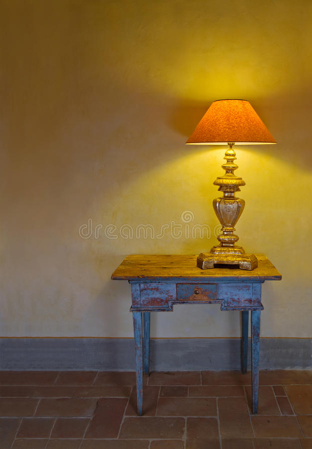 Antique Interior With A Lamp On A Table Stock Photo