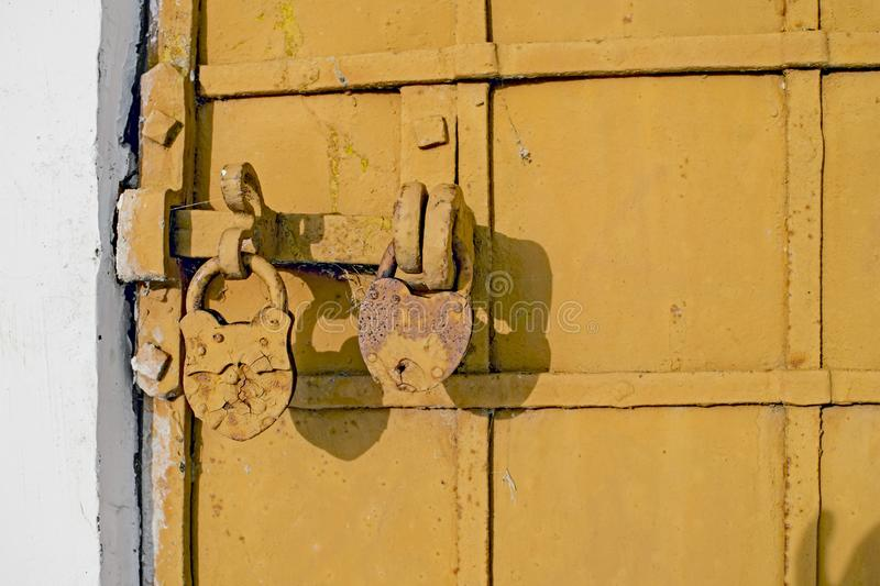 Antique iron-bound door with a latch on two locks close-up royalty free stock photography