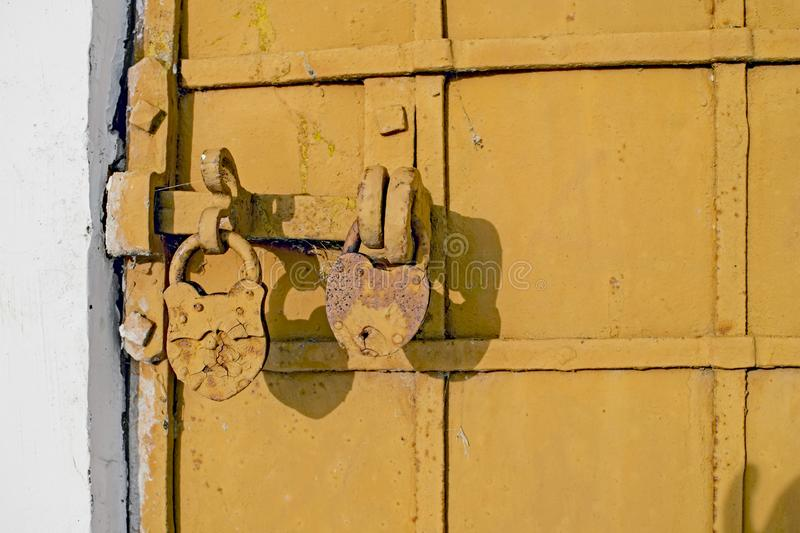 Antique iron-bound door with a latch on two locks close-up stock images