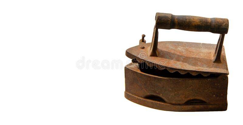 Antique iron on white background. Old rusty iron for ironing. Antique household item.  stock images