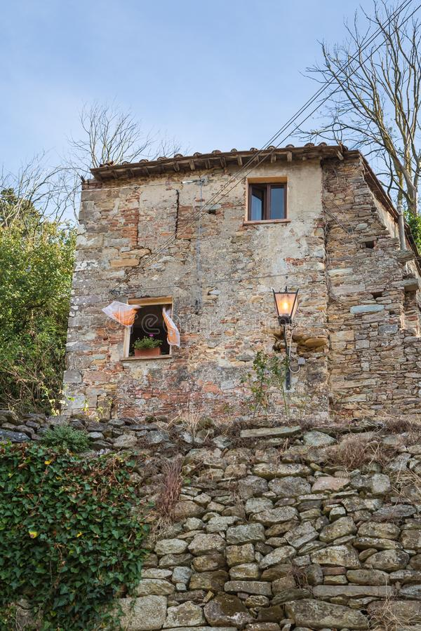 Antique Italian Architecture: House with Stone Facade and Lamp in Countryside.  royalty free stock photography