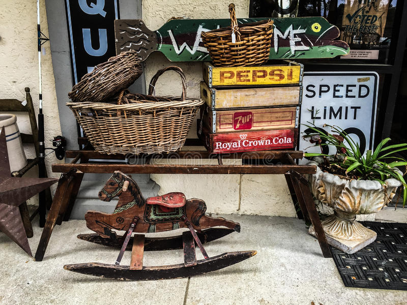 Antique items for sale. Vintage and antique items on display outside an Antique shop in Mount Pleasant, SC, for sale royalty free stock photos
