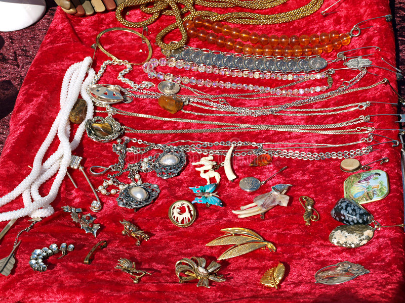 Antique jewelry display. Display of antique jewelry in a flea market stock image
