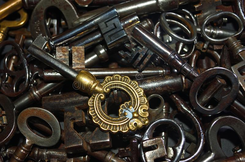 Antique Keys in a pile steel and brass stock image