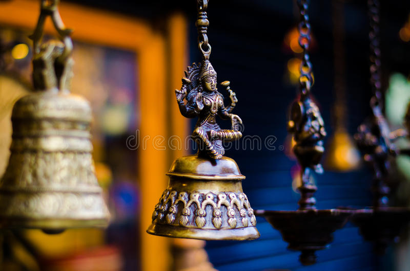 Antique Lakshmi bell and lamp shop. A bell with Goddess Lakshmi, other similar ones are in the background. Location: Antique Shop, Town Mattancherry, Kochi royalty free stock photography