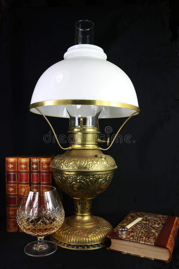 Antique Lamp and Leather Books stock image