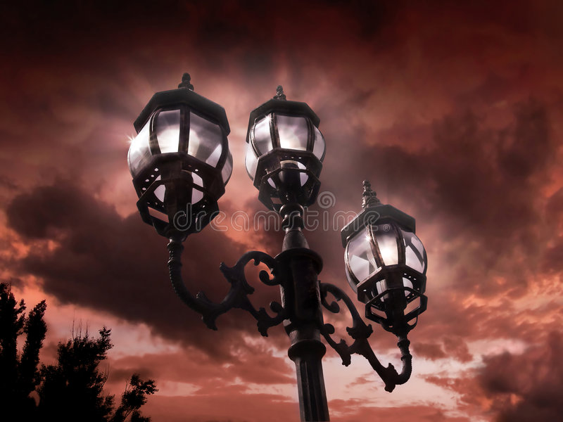 Antique lamp post. Old fashioned lamp post against evening sky royalty free stock image
