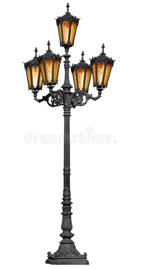 Antique lamp post on white. Antique cast iron lamp post isolated on white background stock image