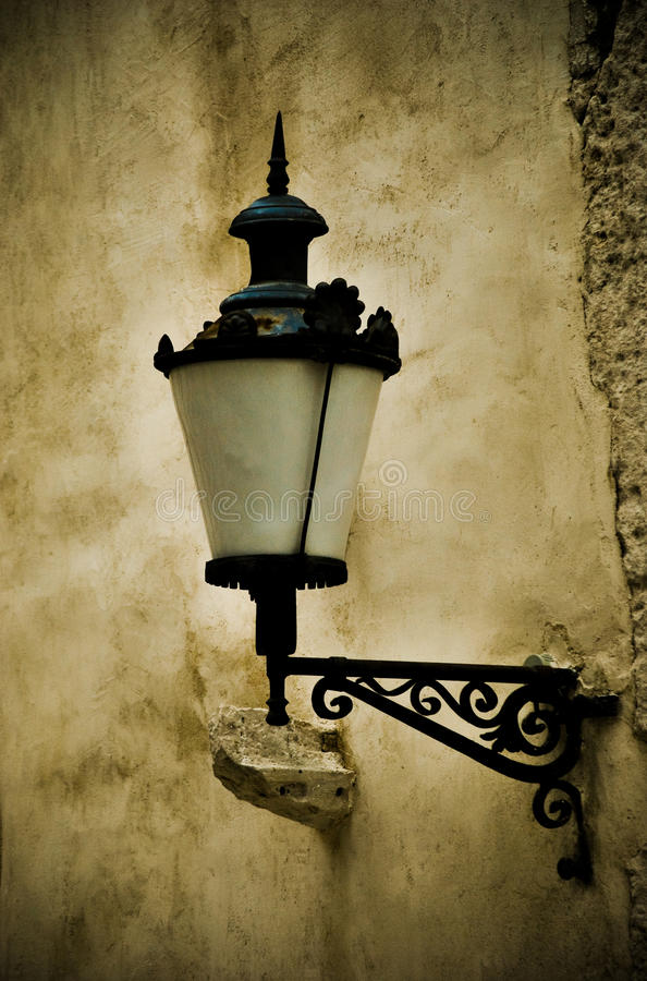 Antique lantern. Attached to a wall on a side street of Split, Croatia stock photo