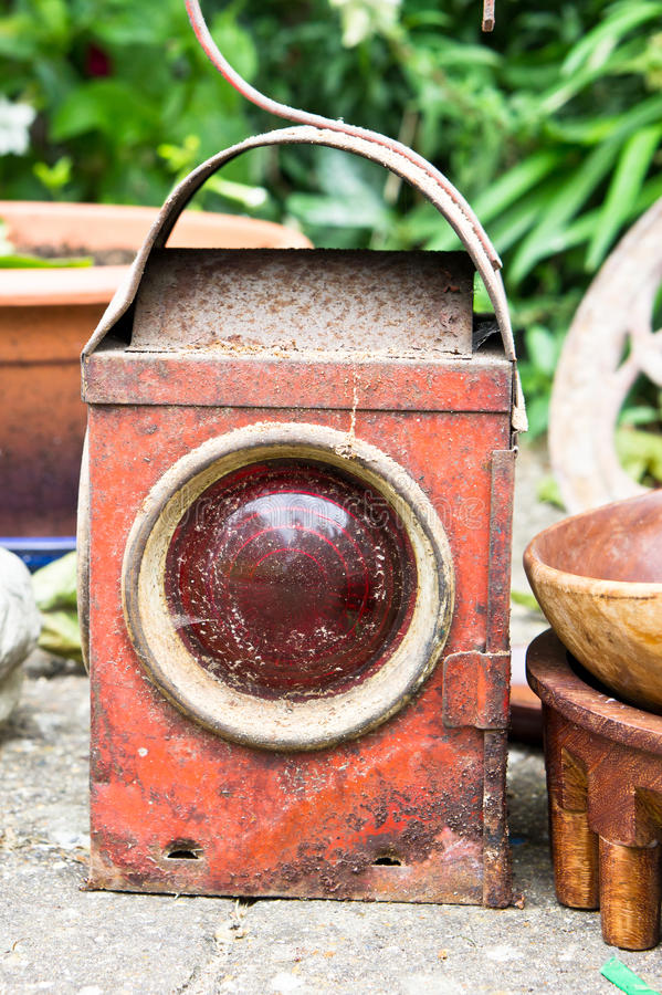 Antique lantern. A rusty antique lantern at a second hand market stock image