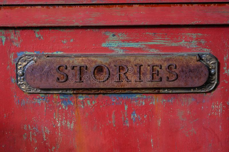 Antique letter slot relabeled as stories royalty free stock photography