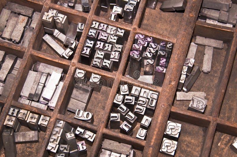 Antique letterpress printing blocks stock image