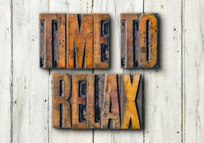Antique letterpress wood type printing blocks on a white backgound - Time to relax royalty free stock photography