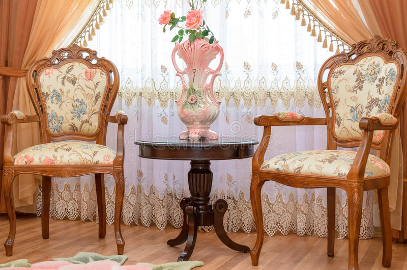 Antique luxury wooden chairs in interior of the royalty free stock photo