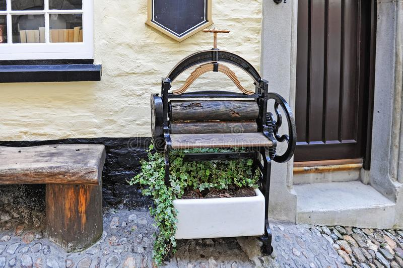 Antique mangle Victorian press with plant stock photography