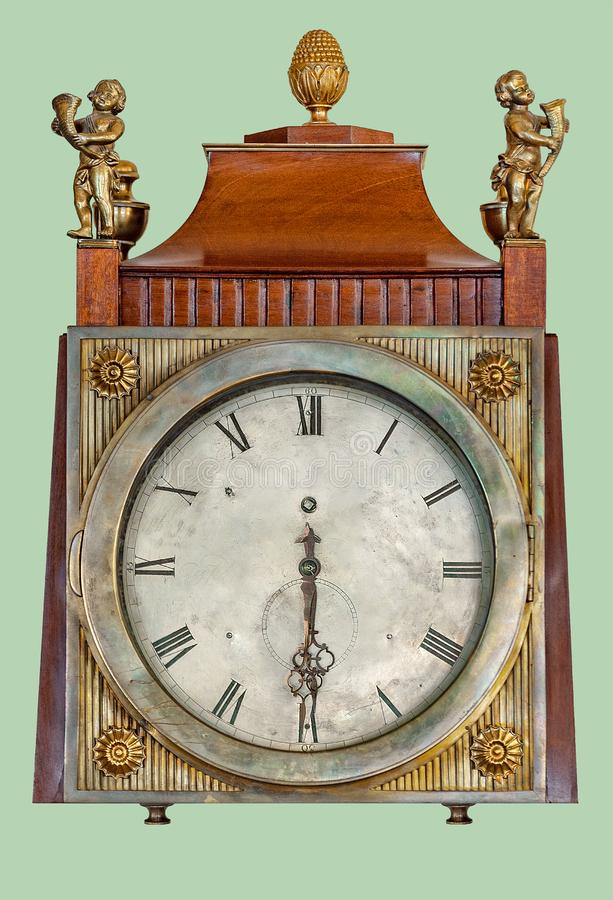 ANTIQUE MANTEL CLOCK WITH BRASS CHILDREN STATUETTES. Antique mantel clock of brass children statuettes, on isolated green background with clipping path royalty free stock photos