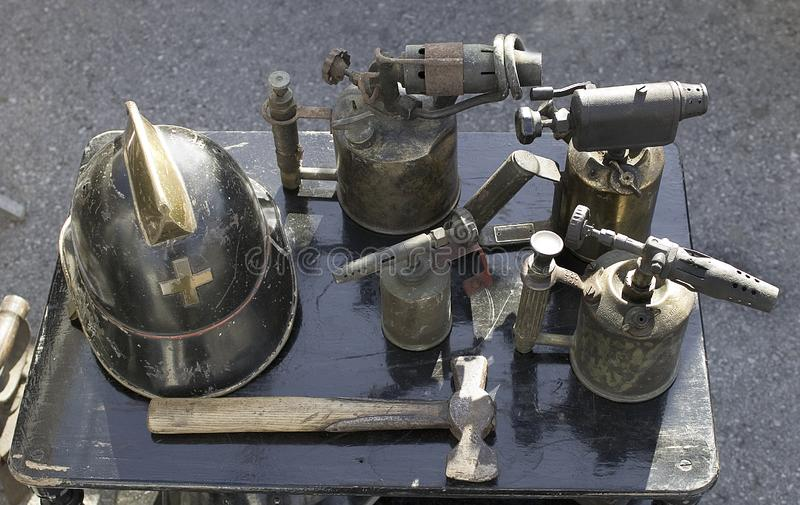 ANTIQUE MARKET. Helmet, hammer, blowtorch.