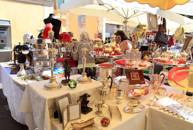 Antique market in Nice, France. NICE, FRANCE - MAY 13: The Cours Saleya at the French Riviera famous of antique market every Monday in Nice, France at May 13 stock photos