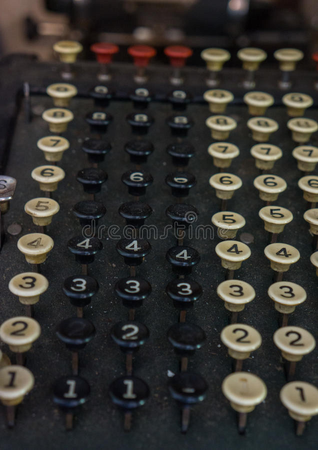 Antique mechanical calculator stock image