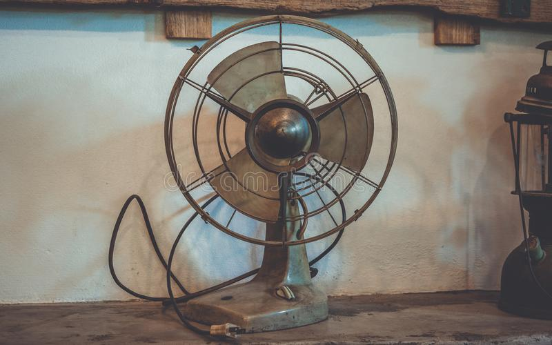 Antique Metal Fan On Table royalty free stock photo