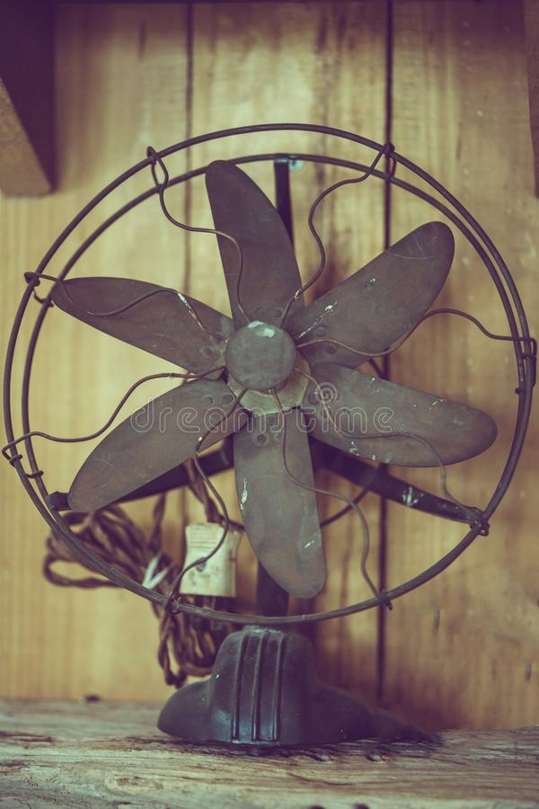Antique Metal Fan On Table stock images