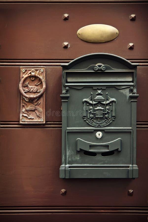 Antique metal mail box and old door knob stock photos
