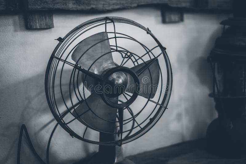 Antique Metal Fan On Table stock photography