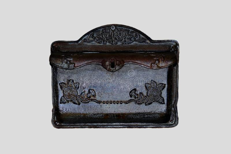 Antique metal post box with floral decorations isolated stock photography