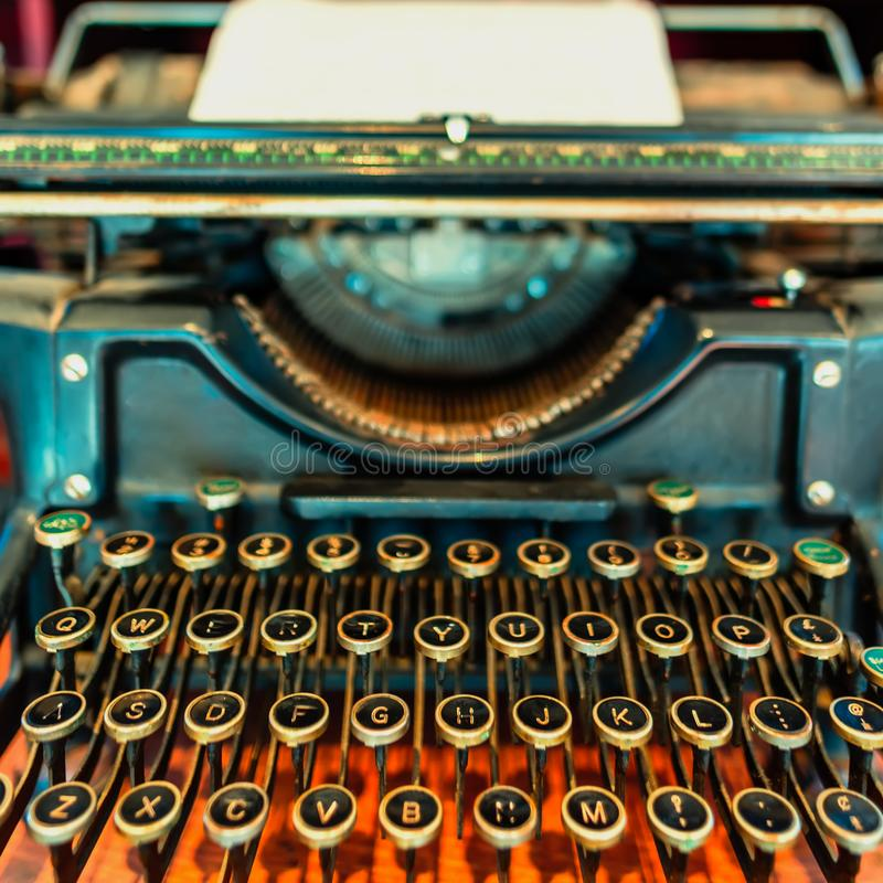 Old, mechanical typewriter with a sheet of white paper royalty free stock images