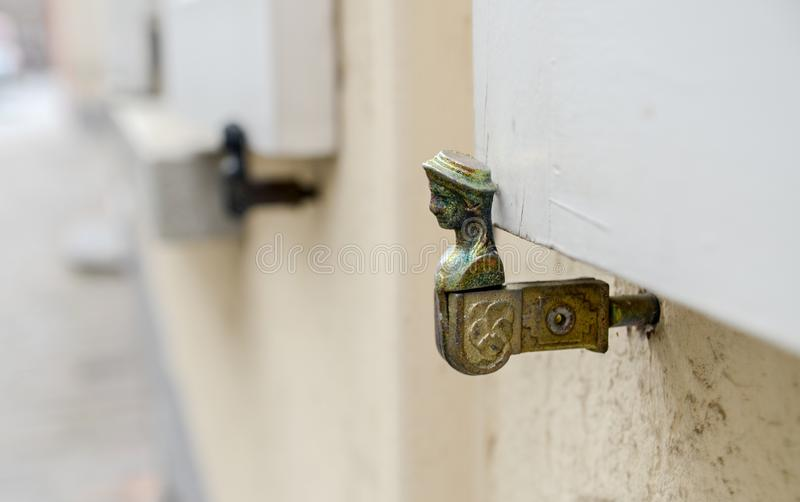 Antique metal window shutter holder royalty free stock photography