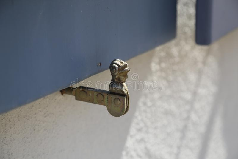 Antique metal window shutter holder stock photos