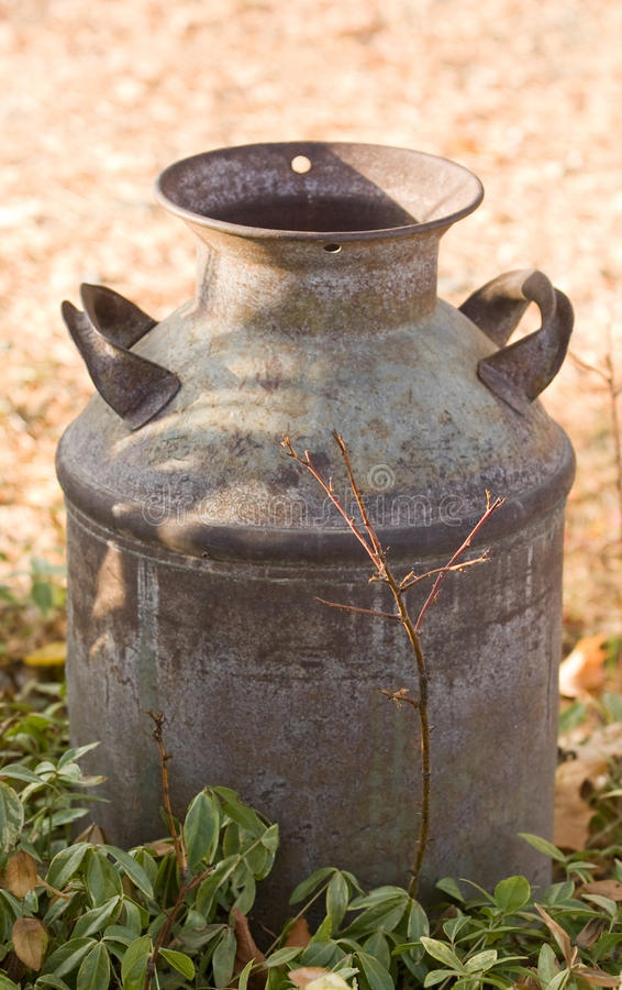 Antique Milk Can on farm royalty free stock images