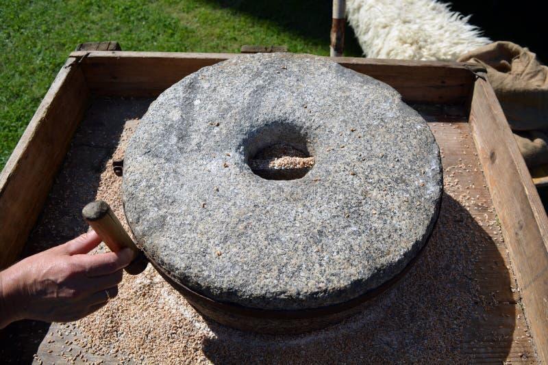 Antique millstone on exhibit stock photos