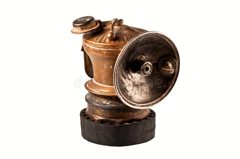 Antique mining lamp. Antique gold miners lamp, isolated stock photo