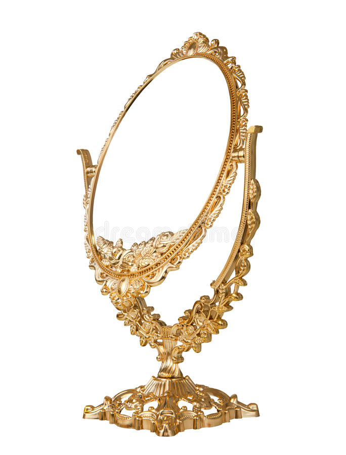 Antique mirror. Antique baroque brass gold frame and mirror isolated on white background stock photo