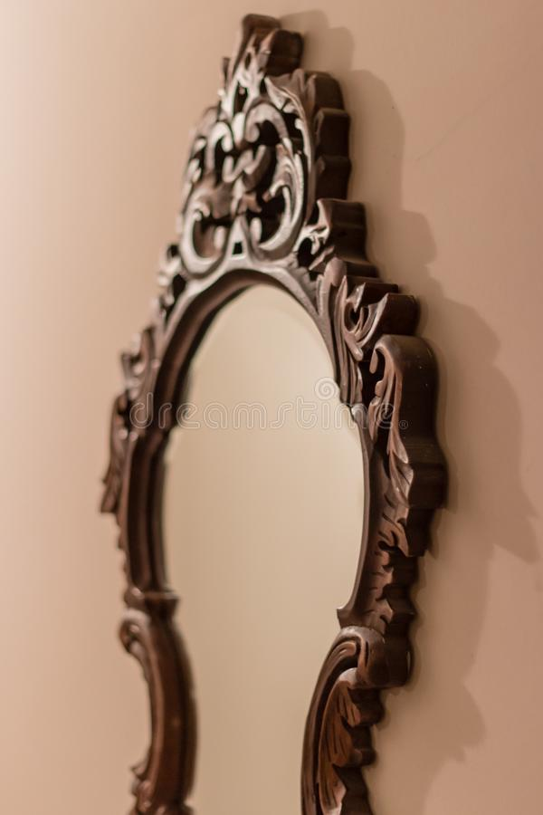 A antique mirror with brown frame royalty free stock images