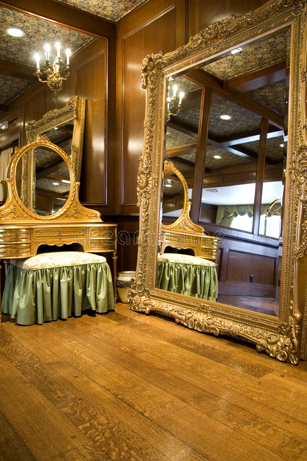 Antique Mirror and Dresser. Expensive Antique Mirror and Dresser with Hardwood Floors royalty free stock photos