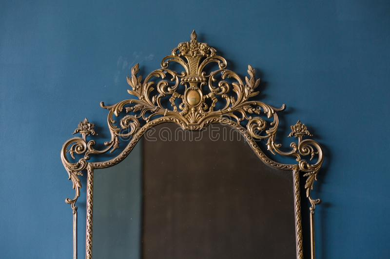 Antique mirror gold patterned frame blue background royalty free stock photos