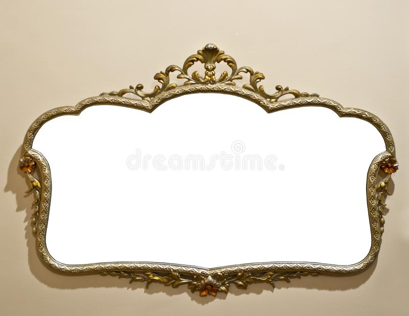 Antique mirror on grunge wall royalty free stock photography