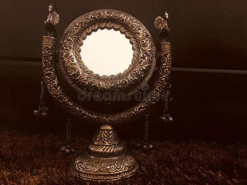Antique mirror. Stock image of a copper antique mirror stock photography