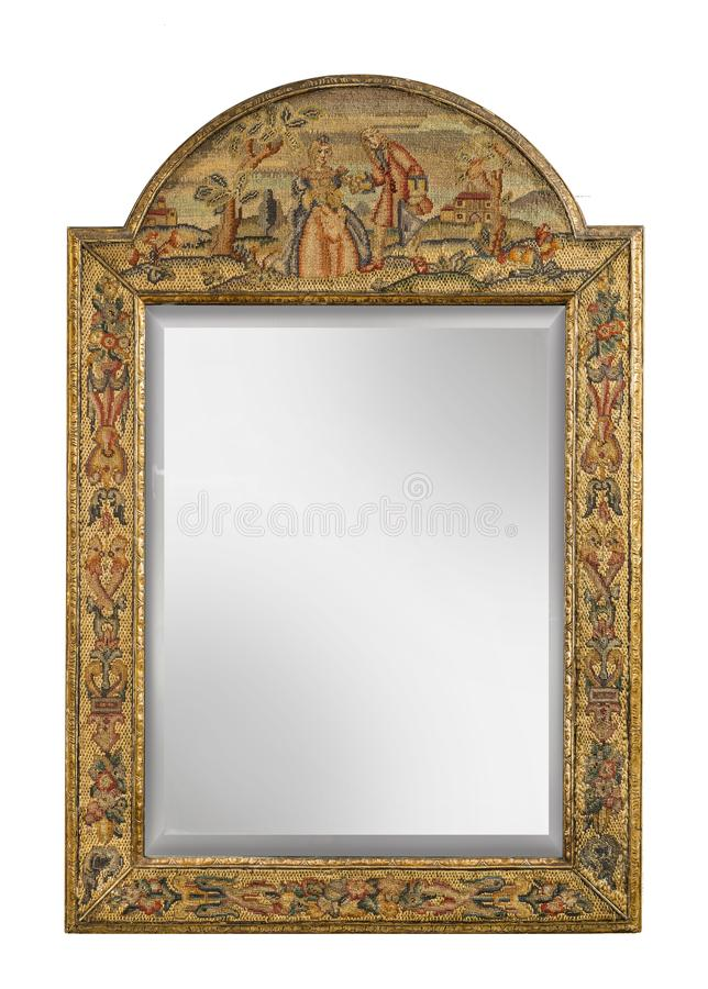 Antique mirror with tapestry covered frame isolated on white stock photography