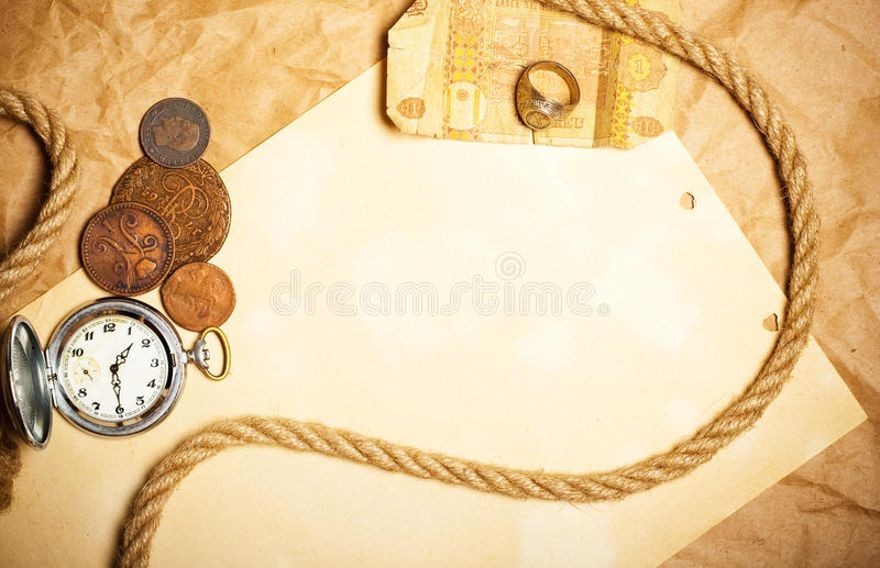 Antique money with watch. And rope royalty free stock photography