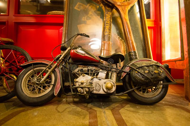 Antique Motorcycle Figure, Old Toy Collection. royalty free stock photography